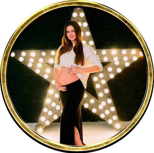 Фото беременной девушки.